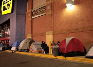 Customers camp out in front of a Minnesota Best Buy store for Black Friday bargains.
