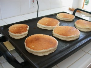 Cooking up pancakes on a stove top griddle.